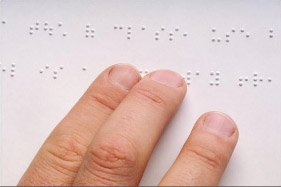 Three fingers reading braille