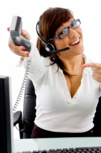 Photo of woman operator holding out phone image from freedigitalphotos